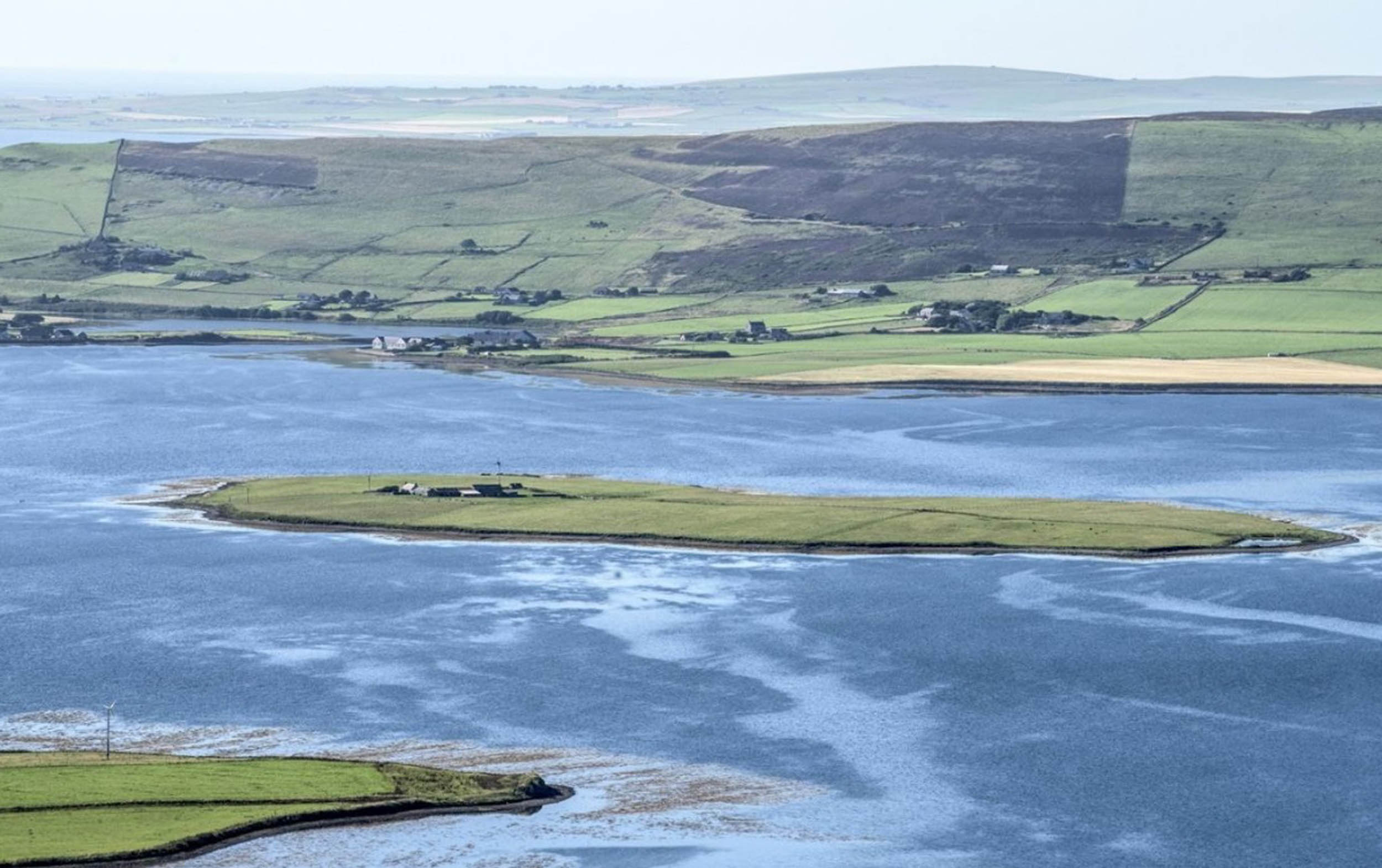 "A REMOTE Scottish island with 40 acres, free electricity and a seal colony is up for sale for half the price of an average London home. The Holm of Grimbister, off the coast of Orkney, is on the market for the first time in 20 years, for just £300,000. The island, once described as the ""loneliest farm in Britain"" also includes a one-bedroom cottage, as well as a mill and a stable. The current population of the island is three, making it 800 times less densely populated than central London. Inhabitants of the Holm can reach the mainland by foot, via a seaweed covered causeway, or by car, when the tide is out. Jamie Watson of Savills estate agents, who are marketing the island, said the property allowed a buyer to ""get away from it all"" whilst still being able to access amenities. He said: ""Attractions include seal colonies and a wonderful array of nature and wildlife."