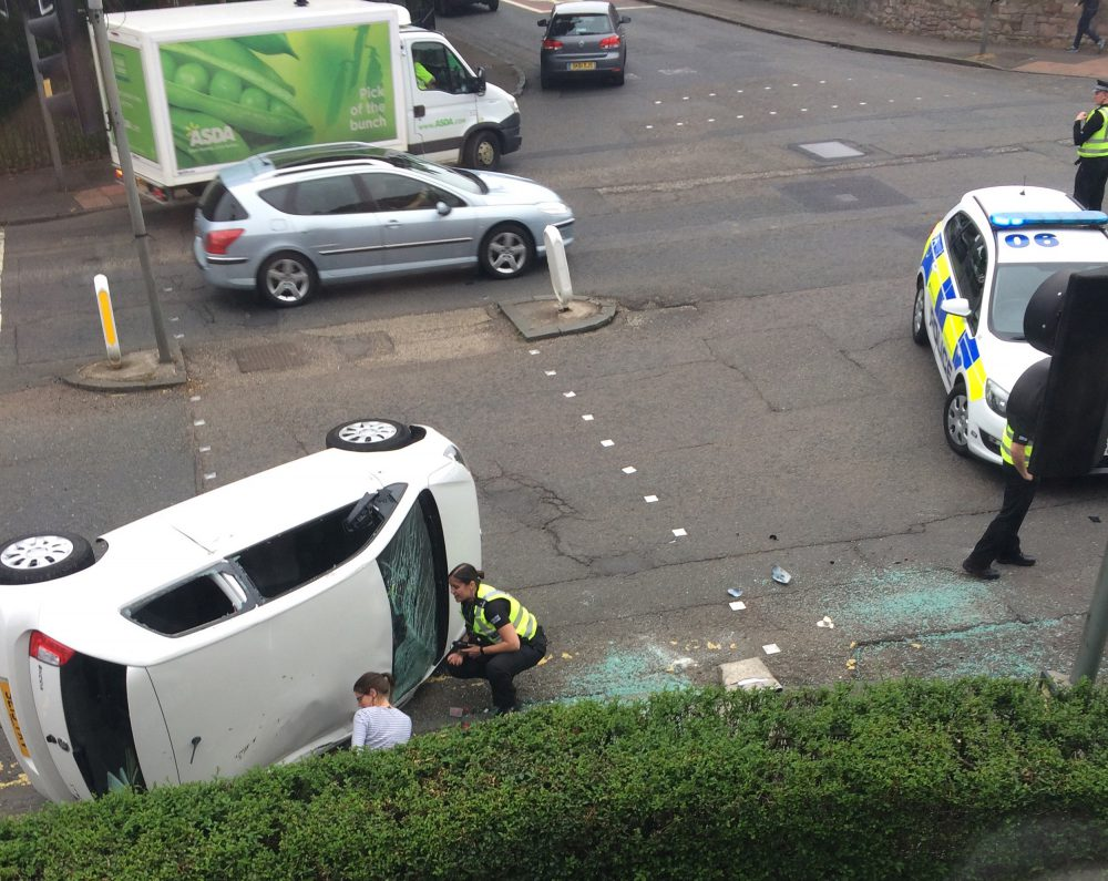 A SCOTS couple have appealed for witnesses on Facebook after a police vehicle on a 999 call hit their car so hard it was flipped on its side. The pair had married just 11 days before the accident, which left Mandy Edmond trapped in the car. She suffered whiplash and needed counselling for trauma. Mandy, 32, and Derek, 39, claim the police car went through a red light at excessive speed and they are furious that Police Scotland has denied liability for the crash in Edinburgh in June this year. The couple's £9,000 car, which was written off in the smash, landed on a pedestrian crossing. After the force refused to accept the blame, the couple decided to post details on social media in a bid to find witnesses to help their case. It recently emerged that in 2013-14, Police Scotland cars were involved in 1,555 collisions - including 113 during emergency call-outs.