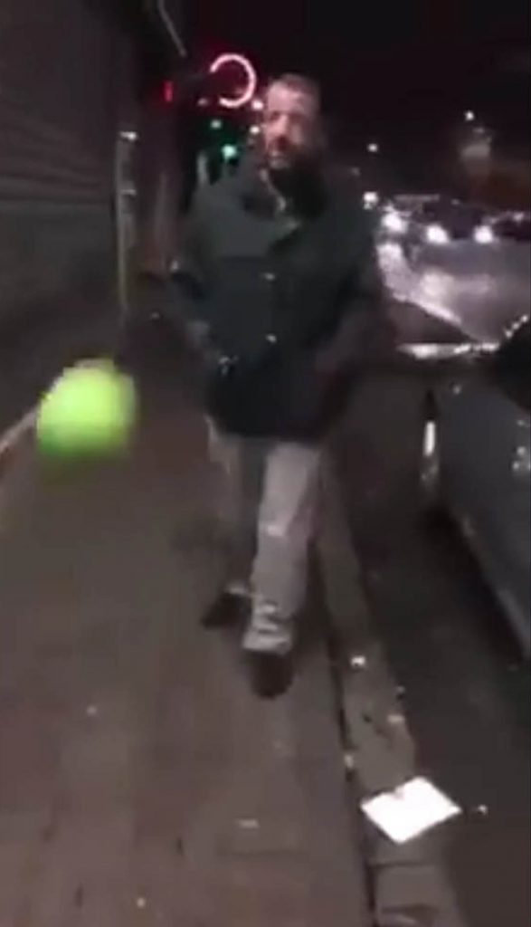 A FOOTBALL fan with the hardest skull in Scotland has been filmed crashing  into a metal shop shutter after a game of keepie-uppie goes wrong.