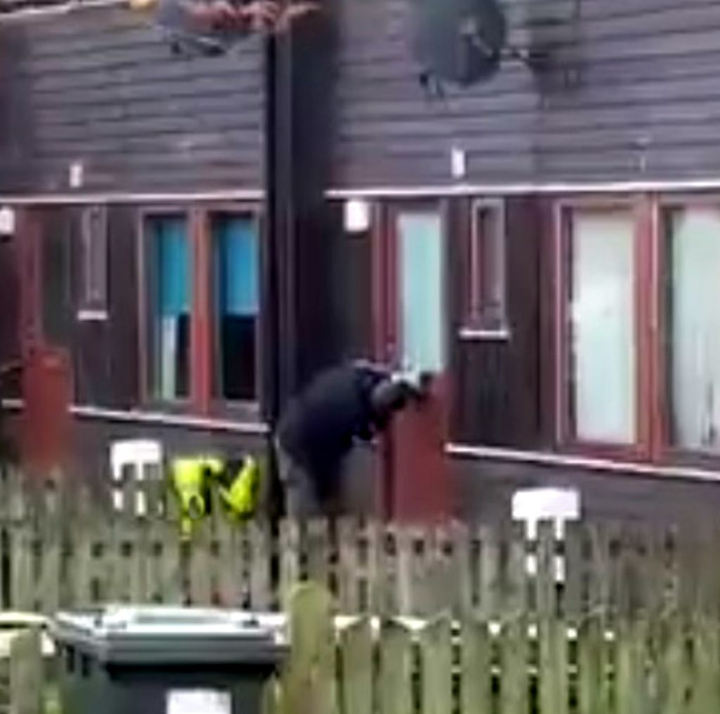 A DELIVERY man's heroic battle to force a parcel through a letterbox has been captured on video.
