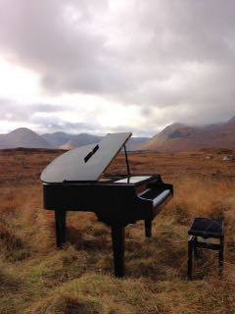 "A BIZARRE image of a mystery man playing a baby grand piano in the middle of a windswept Scottish moor has left the internet baffled. The musician, who is wearing red gloves and has his hood up and head turned away from the camera, is playing the instrument on Rannoch Moor with the mountains of Glencoe in the backghround. The caption states: ""Casually playing piano at Rannoch Moor on Sunday afternoon....as you do"". Gavin Morrison, 49, from Gourock, Inverclyde, spotted the weird scene and took the picture while  driving home from a day out. His wife, Catriona, 52, who uploaded the image said: ""We couldn't believe our eyes when we saw the guy with the grand piano at the side of Rannoch Moor!"""