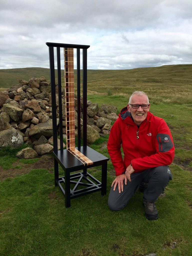 Michael Yuill with his chair on the Campsie Fells