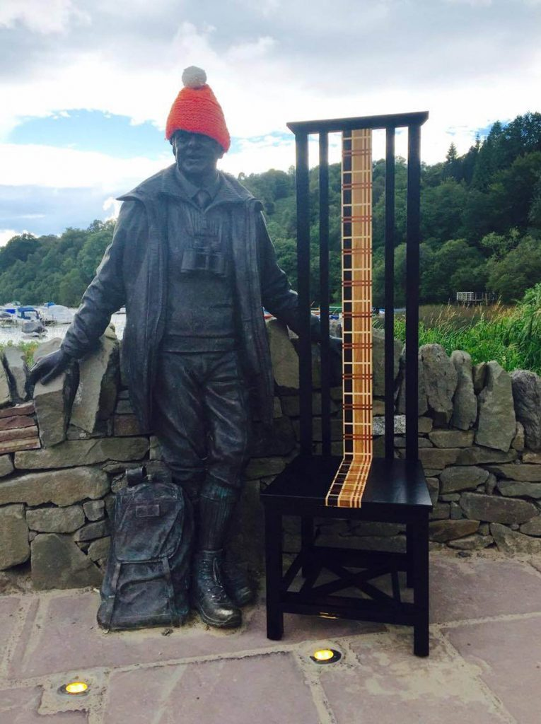 Michael Yuill's chair with famous Tom Weir's statue at Loch Lomond A JOINER who was almost killed by a stroke has created a 25kg chair which he photographs in iconic Scottish locations as a symbol of recovery. Michael Yuill was left in a coma, unable to walk and temporarily blind when the stroke struck six years ago. But he recovered enough to build the tartan chair and then haul it to dozens of locations hundreds of miles apart in Scotland. The 53-year-old ran his own joinery business and climbed Scottish peaks before he was left disabled by the incident. The chair is made completely from reclaimed wood, and is painted wholly black, except a tartan strip along the back. The plan to take the furniture across Scotland was first suggested by his friends as a joke, but now, Michael, his ten-year old son Josh, and his pals take it on all their trips, including hiking with it up several hills in the Campsie Fells, Stirlingshire. Other locations they have visited with it include the southern point of the West Highland Way at Milngavie, which Michael walked completely before his stroke, and Loch Katrine. He has taken the furniture as far afield as Dunnottar Castle, a ruined medieval fortress in Stonehaven, some 130 miles from his Glasgow home, and even plans to take it to Ben Nevis.