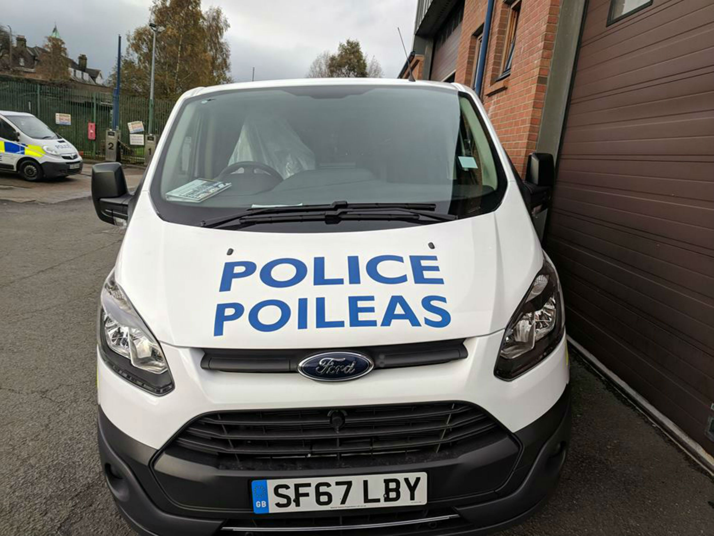 Gaelic police vans slammed after is unveil