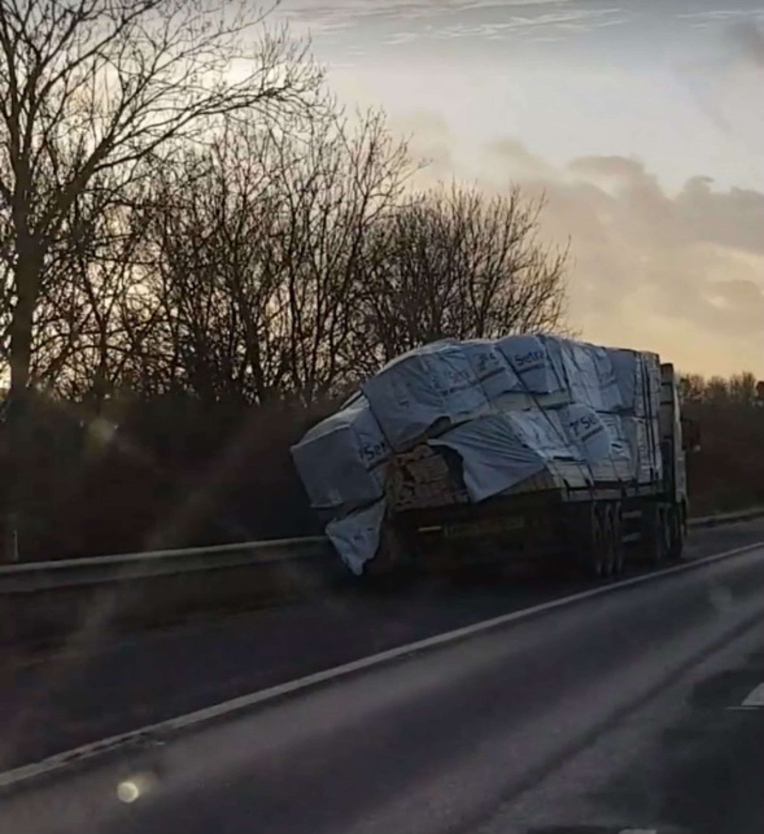 Driver of swaying HGV stays on motorway until load falls off