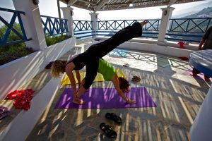 Holidaymakers on balcony of Greek island yoga retreat