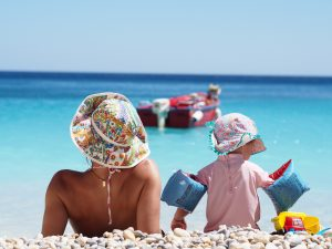 Young family on holiday beach near Greek yoga retreat