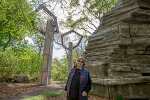 Phyllida Barlow beside her Quarry installation