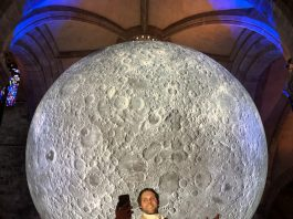 Actor Gareth Morrison plays Burns in front of Museum of The Moon, St Giles' Cathedral as part of Burns&Beyond Festival