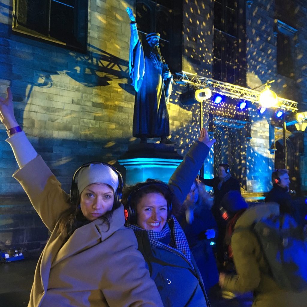 revellers dancing to the silent disco as part of the Burns and Beyond Festival in the shadow of John Knox.