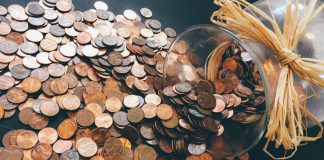 Pennies pour out of glass jar