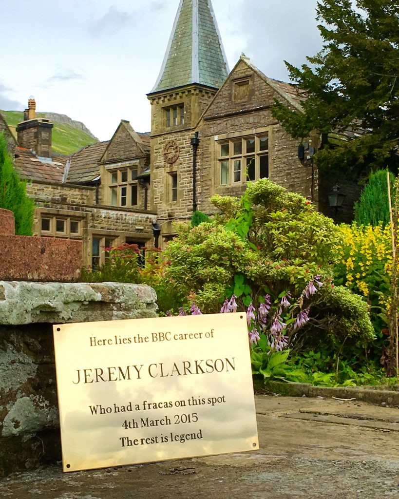 A gold plaque sits in front of Simonstone Hall which reads 'Here lies the BBC career of Jeremy Clarkson'