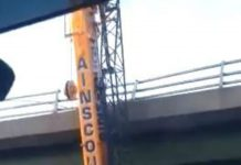 """""""How the f*** he done that?"""" Clip shows giant crane wedged under motorway bridge"""