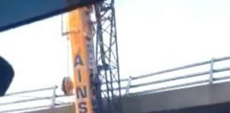 """How the f*** he done that?"" Clip shows giant crane wedged under motorway bridge"