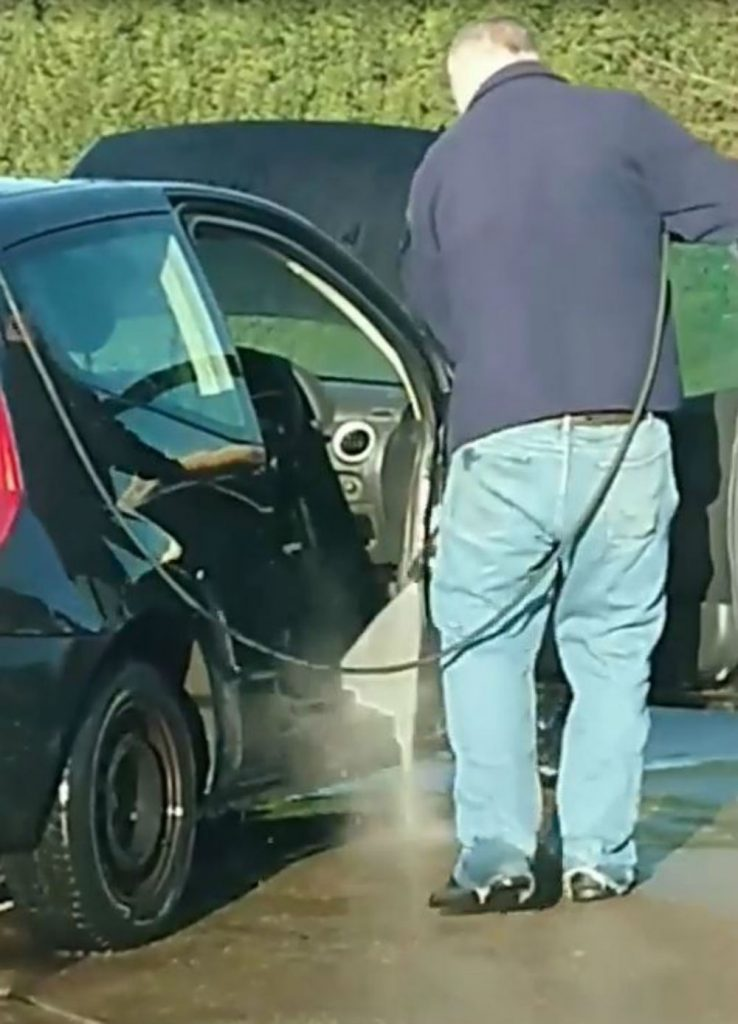 """Defo a serial killer"" Clip of man power-washing INSIDE of car sends internet wild with speculation"