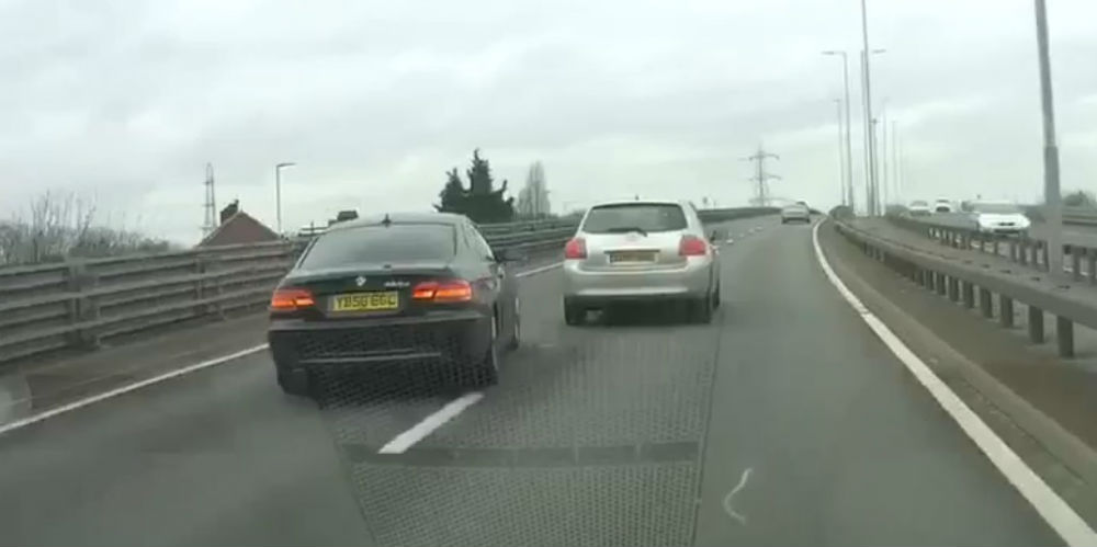 The BMW was forced to swerve to avoid hitting the black Corsa
