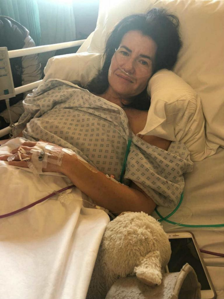 """Mum posts hospital pic after cancer surgery, warning she mistook symptoms for """"too much coffee"""""""