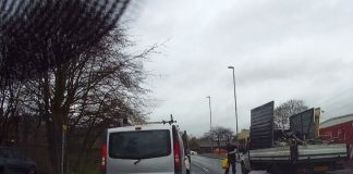 """Scrap man has own rules of the road"" Van almost hits pedestrian, drives on wrong side and jumps red"