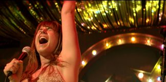 Acrtress Jessie Buckley as the lead character in movie, Wild Rose - review by Jean West for Deadline News