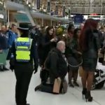 """Whose dad is this?"" Moment ""fetishist chained to Miss Foxx"" confronted by cops at railway station"
