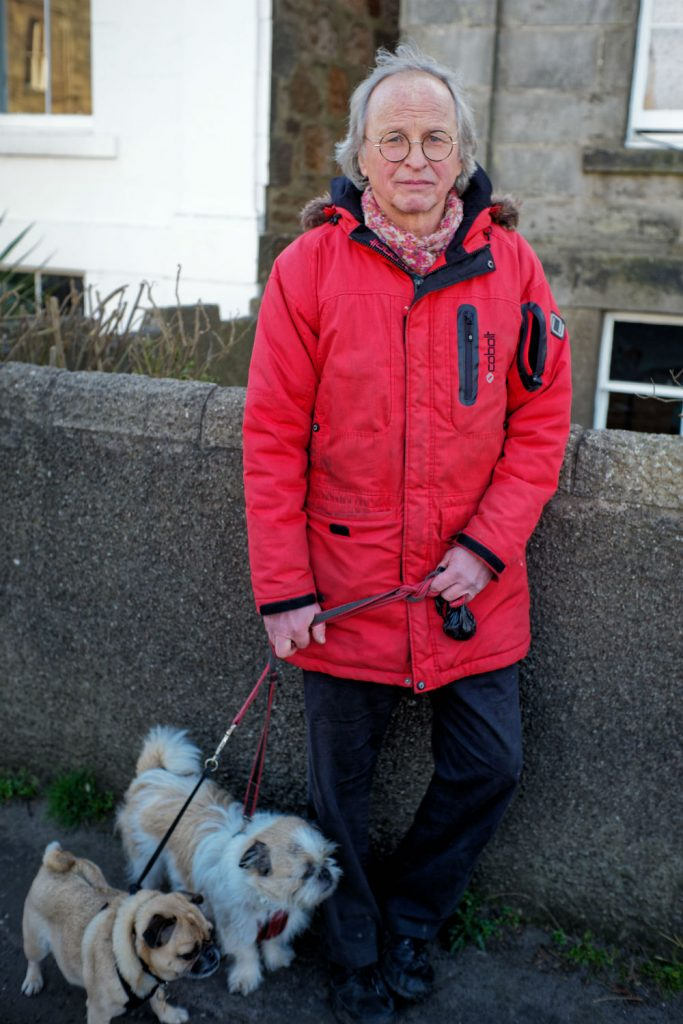 An image of Portobello resident, Lars, with his dogs Boo and Bentley taken by Luke McAdams as part of A Taste of Photojournalism course.