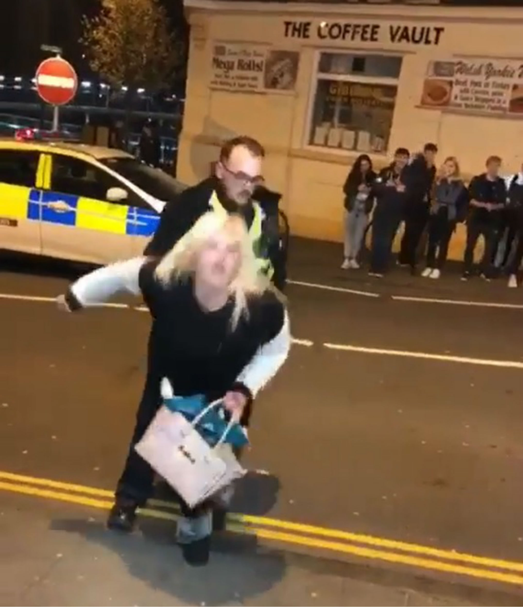 Hilarious video captures the moment a woman twerks on a policeman after asking him to arrest her