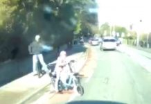 As her bike careers off the road, the driver makes a sudden stop and caught the near miss on his dashcam
