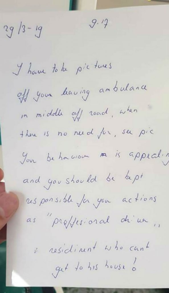 The image shows an abusive letter which was found stuck to NHS ambulance by a resident who could not enter their home due to the ambulance being in the way. Inside the ambulance a paramedic battled to save a young girl's life.