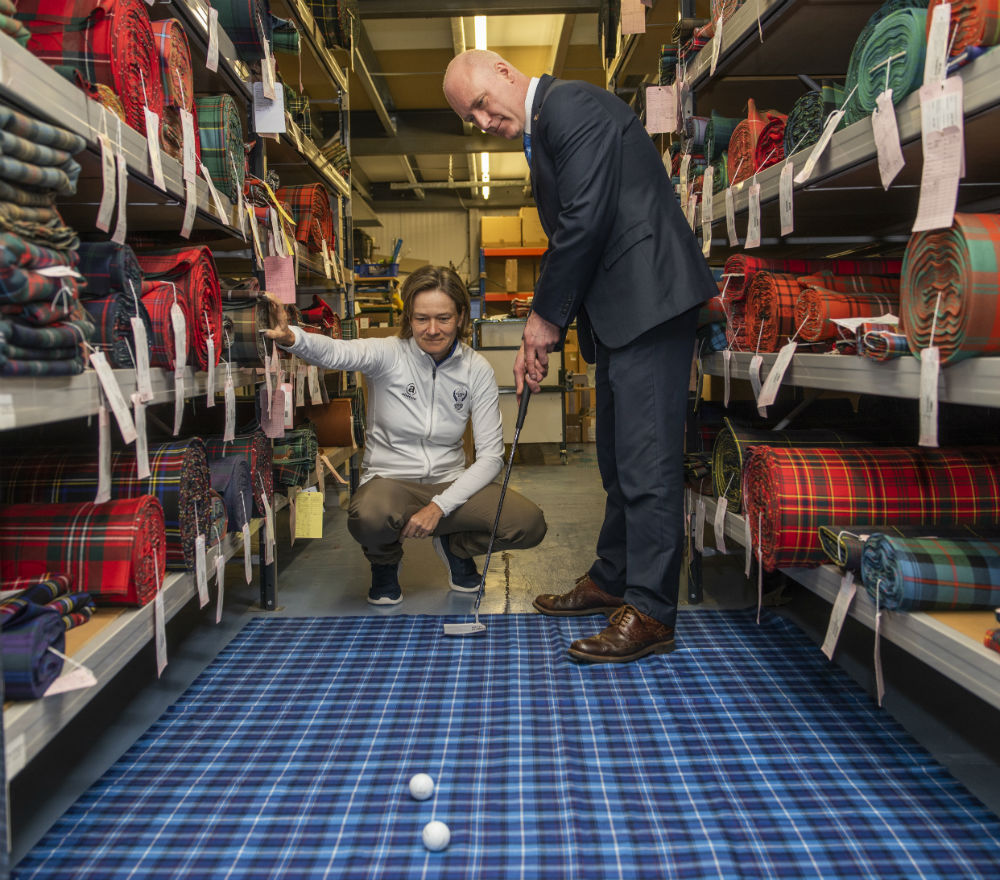 A SPECIALLY commissioned tartan designed to celebrate The Solheim Cup's return to Scotland has been unveiled. Scotland's Minister for Public Health, Sport and Wellbeing, Joe FitzPatrick and European Solheim Cup Captain, Catriona Matthew revealed the design following a factory tour of leading tartan manufacturers, Lochcarron of Scotland in Selkirk. VisitScotland commissioned the company to create The Official Solheim Cup Tartan which comprises a blue, red, yellow and white design to mirror the colours on the flags of Scotland, Europe and the USA.
