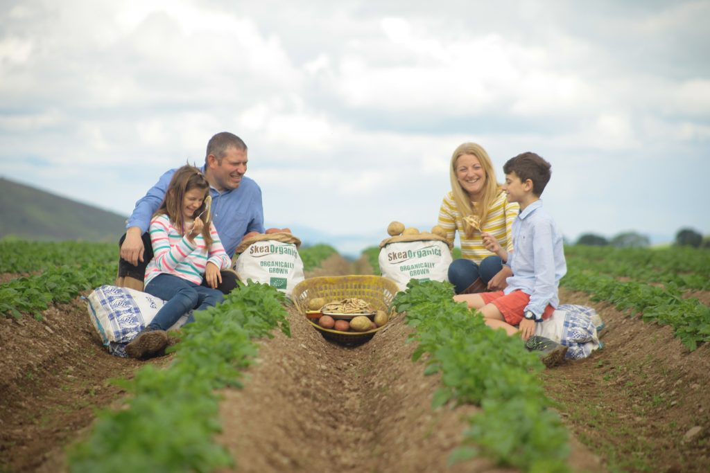 (left to right) Iona (age 7), John, Suse and Innes (age 10) Skea are enjoying an organic breakfast