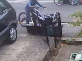 The cyclist going into the rubbish bin
