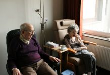 OAPs eating biscuits in a nursing home