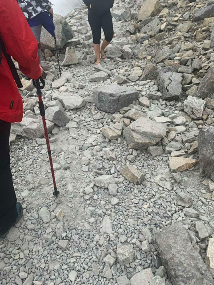 A hillwalker wearing flip flops on Ben Nevis