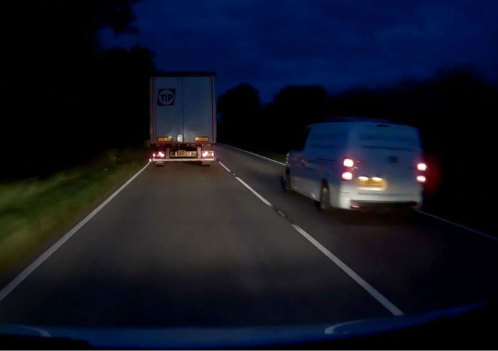 Van speeding past lorry