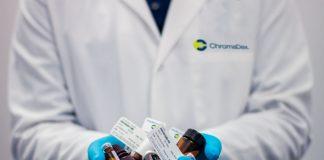 pharmacist holding drugs