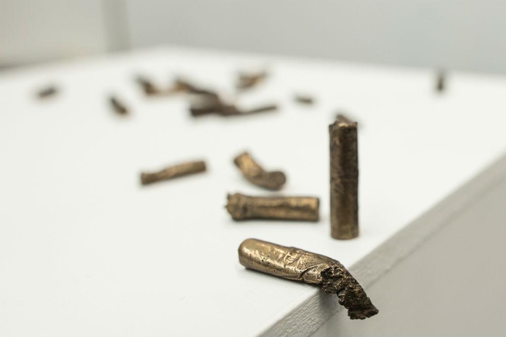 Bronze cigarette butts
