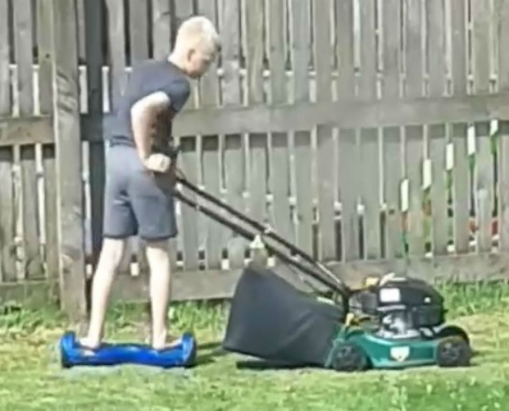Nathan using lawnmower