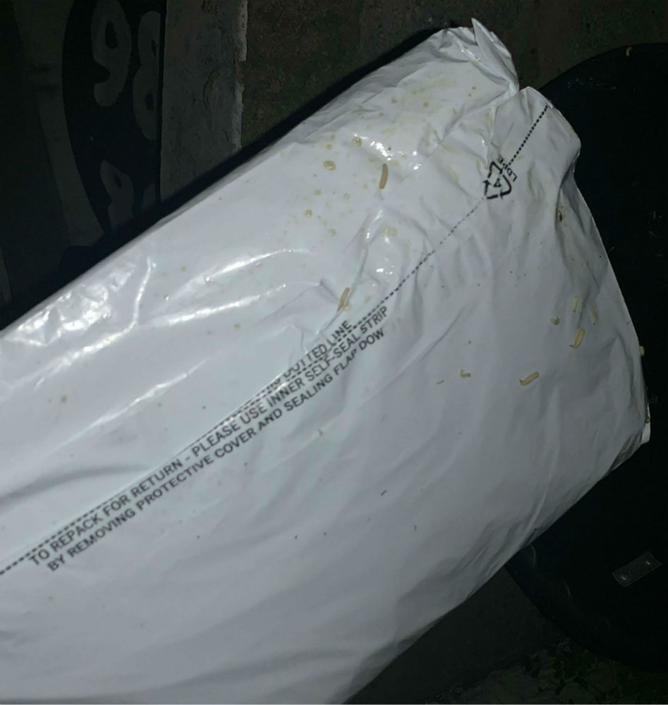 Parcel covered in maggots