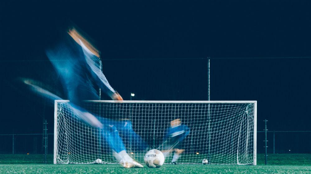 Timelapse of footballer kicking ball