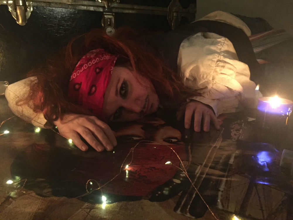 An image of Johnny Depp actress laying on a table