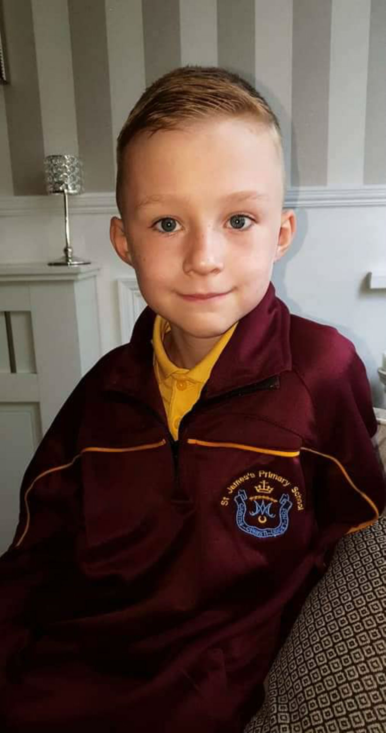A picture of the autistic boy in his school uniform