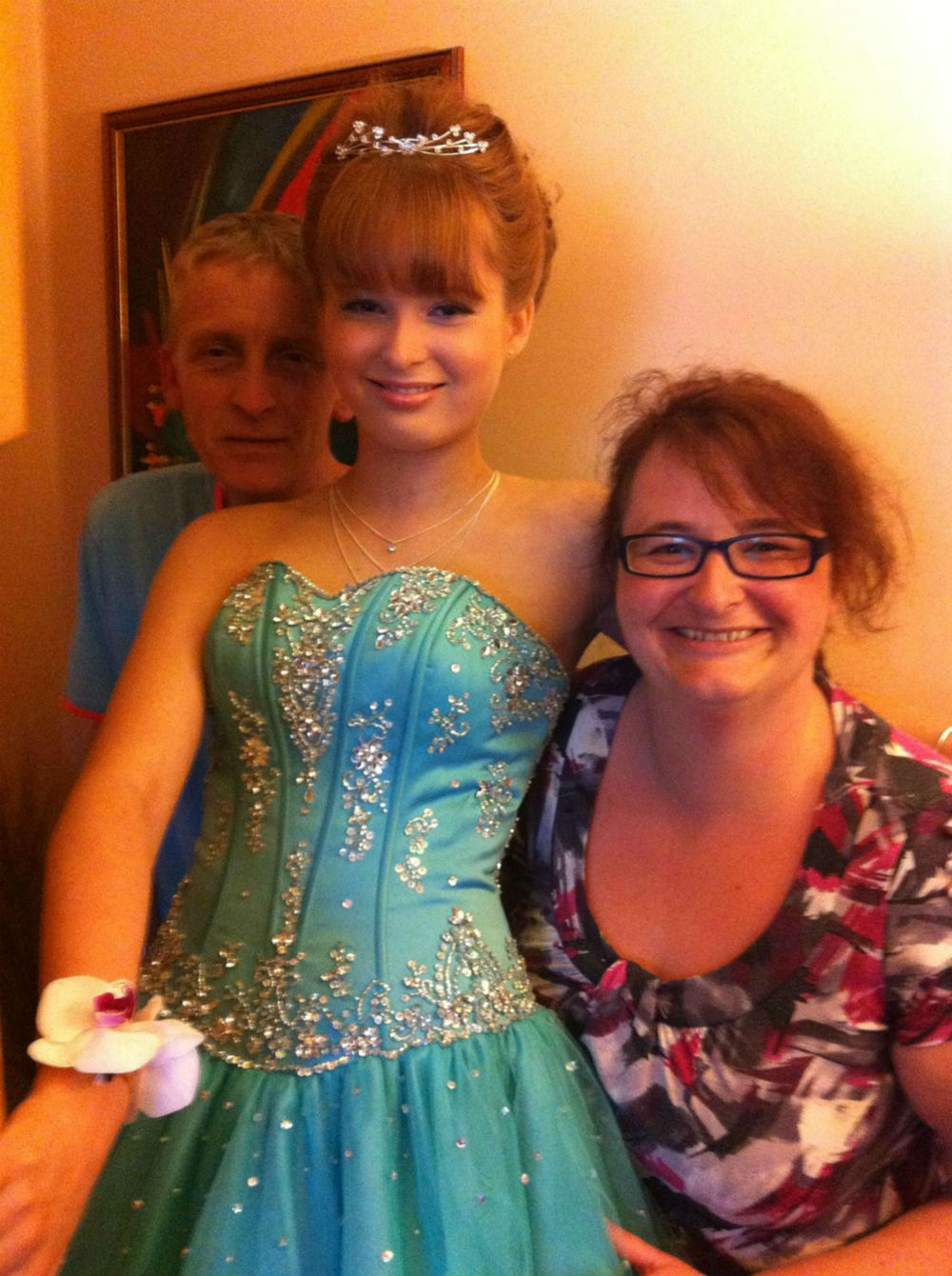 Annabel with her parents on her prom night