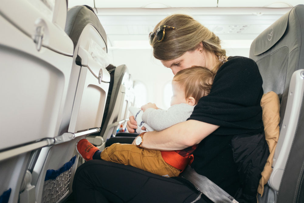 Mother on plane with baby