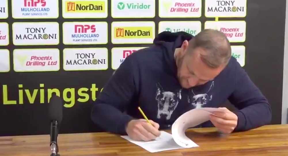 Gary Maley signs his one-year deal during the summer   Livingston news