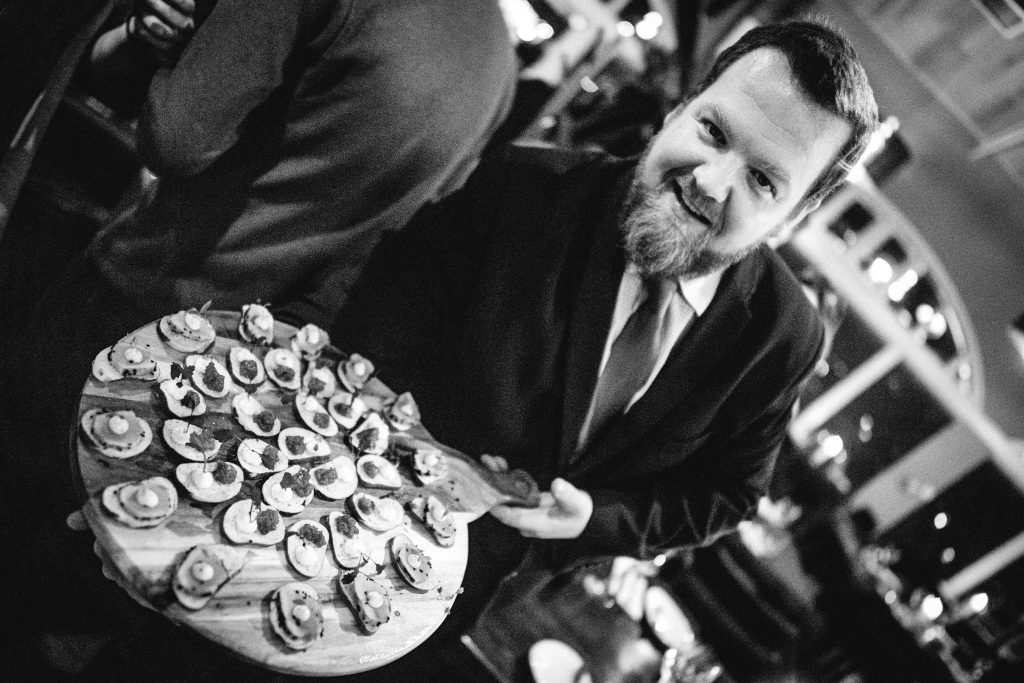 Mark Patyoni of Pier Brasserie restaurant serving canapes at the glittering launch event