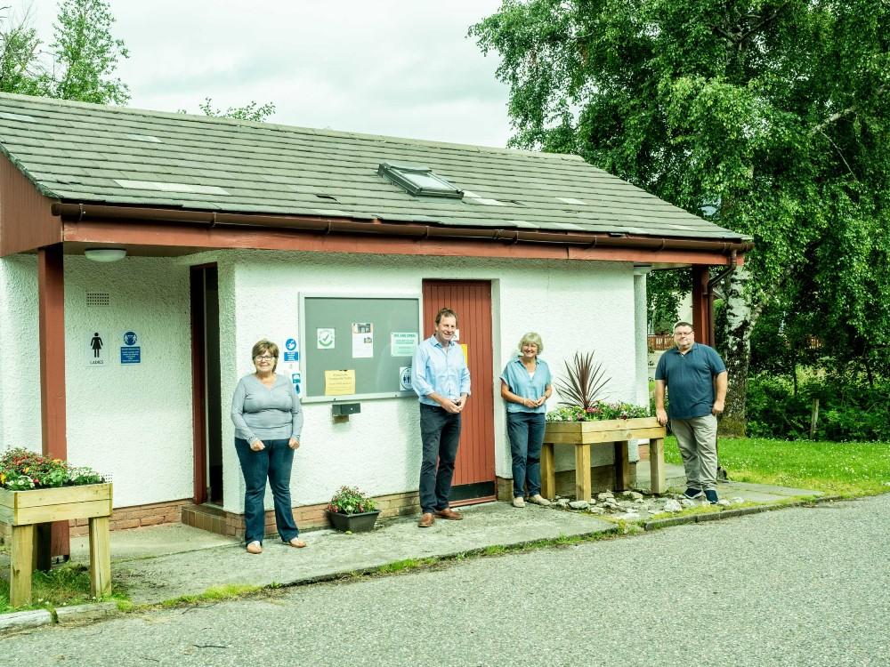 Shieldaig Community Association outside  the Kinlochewe Community Toilets