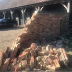 """AN """"UNINSURED"""" Amazon driver has left residents of a hamlet with a £3000 bill after totally destroying a wall."""