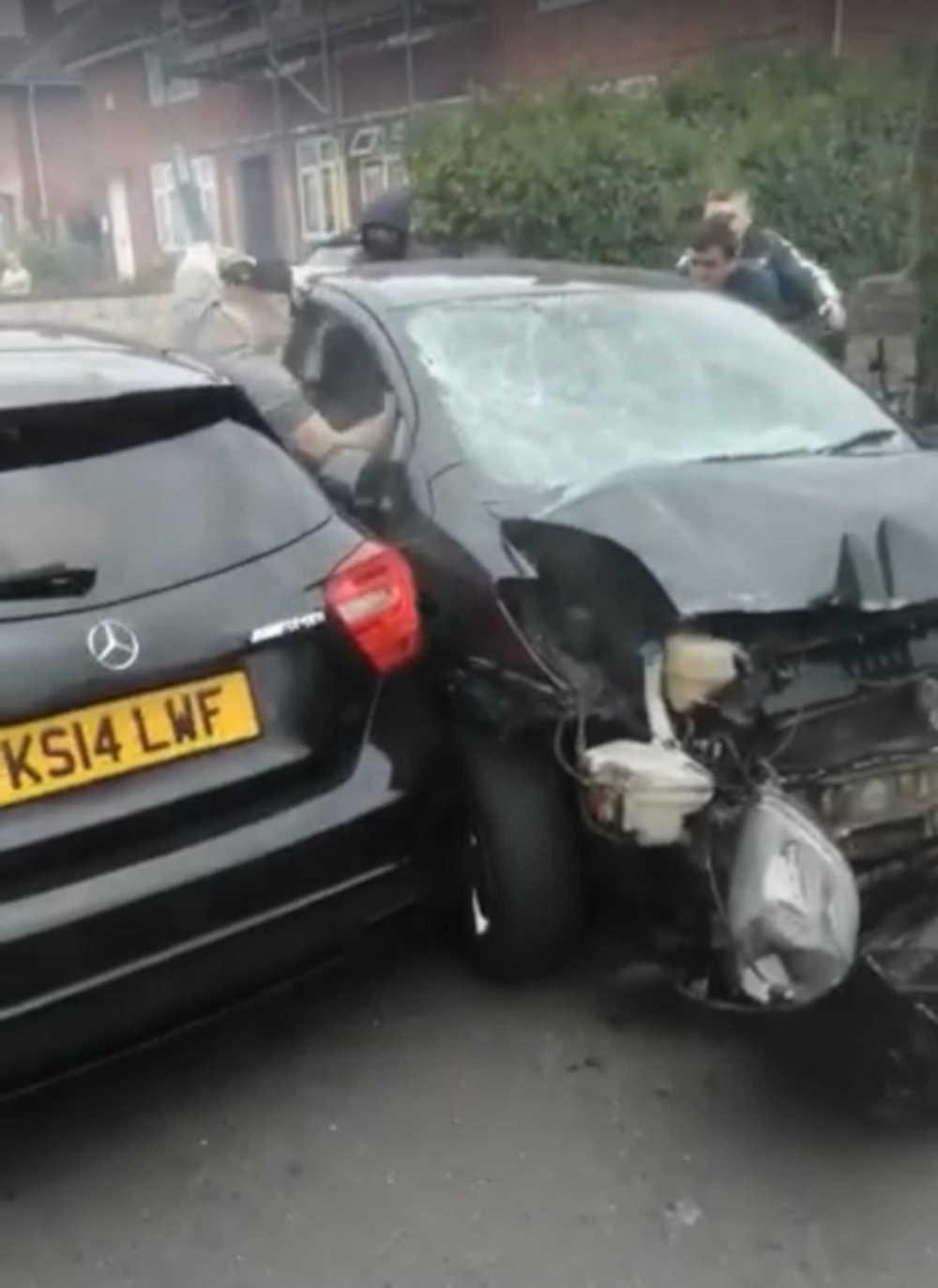Men attacking car