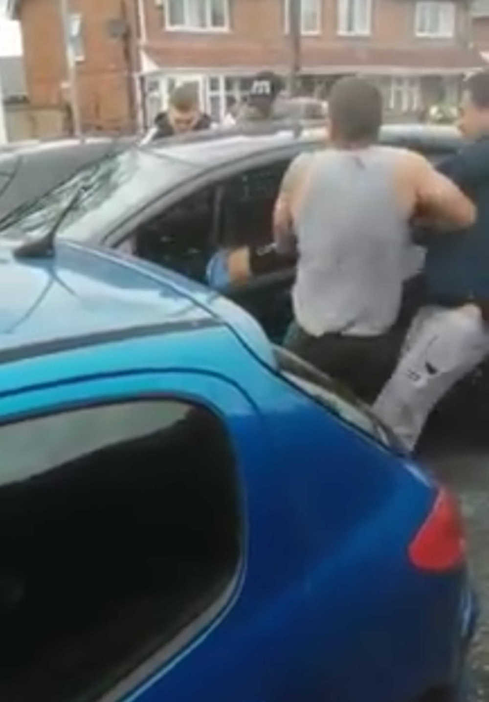 Man dragged through window