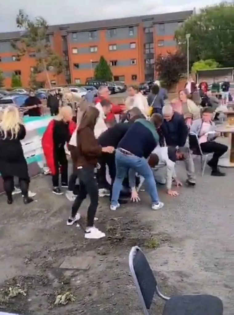 Punters at the White Elephant Pub in Glasgow fighting on the first day beer gardens open